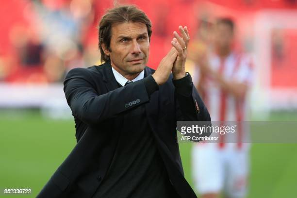 conte applauds supporters on the pitch after the English Premier League football match between Stoke City and Chelsea at the Bet365 Stadium in...