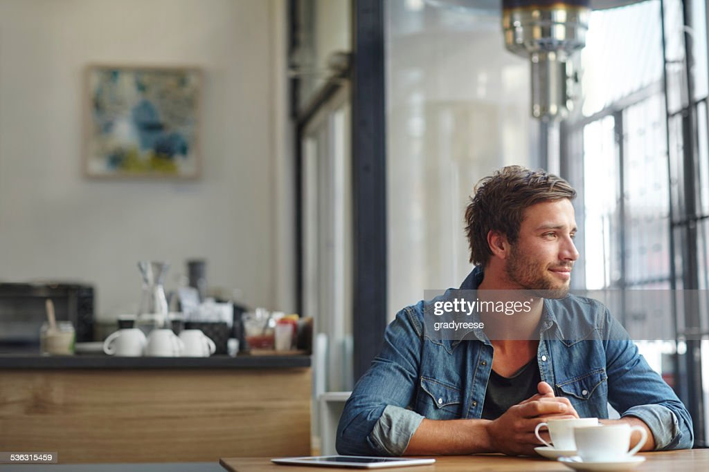 Contemplating things over coffee : Stock Photo