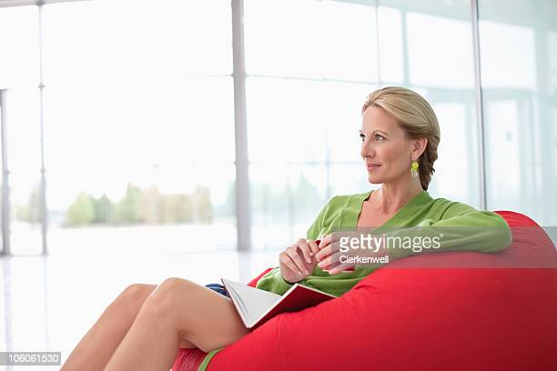 Contemplative Caucasian woman sitting on a bean bag