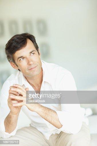 Contemplative mature man looking away : Stock Photo