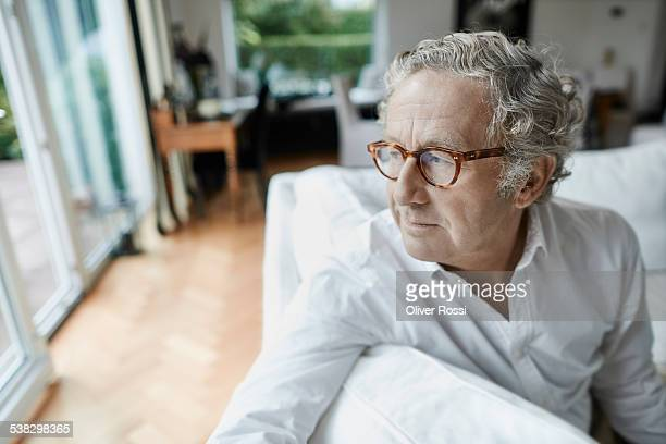 Contemplative senior man at home