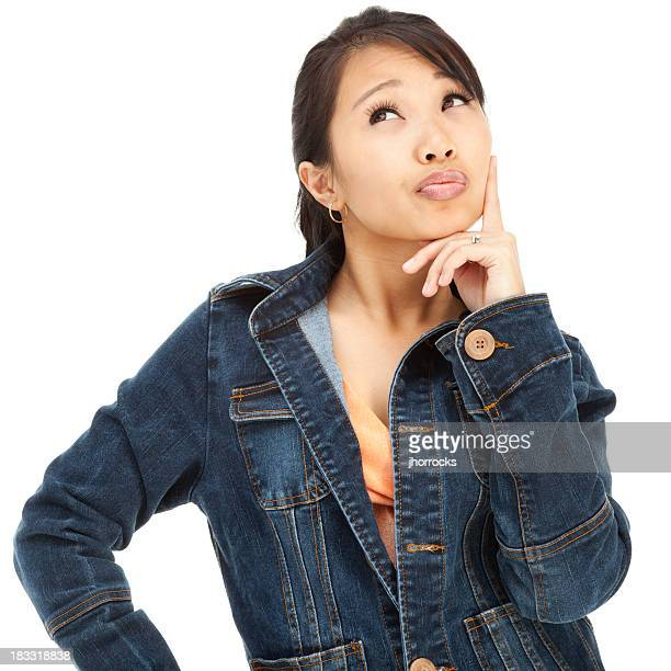 Contemplative Young Asian Woman in Blue Denim Jacket