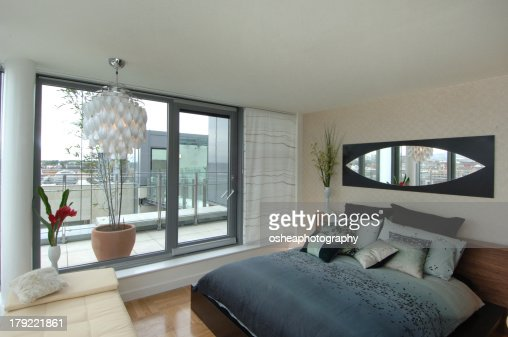 Contemporary Apartment Bedroom with Terrace : Stock Photo