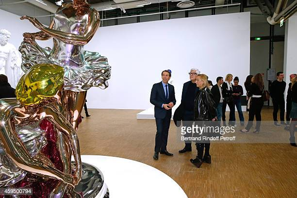 Contemporary artist Jeff Koons Miuccia Prada standing and her husband attend the 'Jeff Koons' Retrospective Exhibition Private Visit at Beaubourg on...