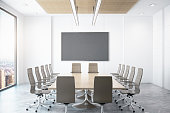 Contemporary conference room with empty chalkboard and city view. Mock up, 3D Rendering