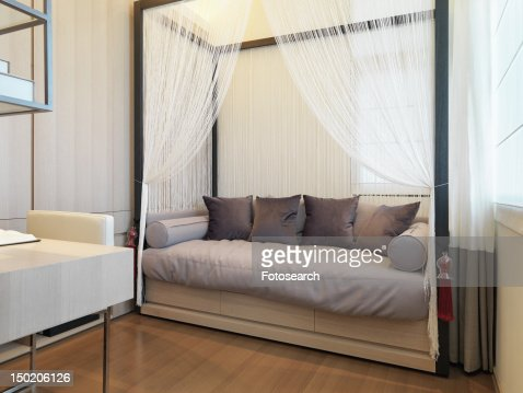 Contemporary daybed with mosquito net