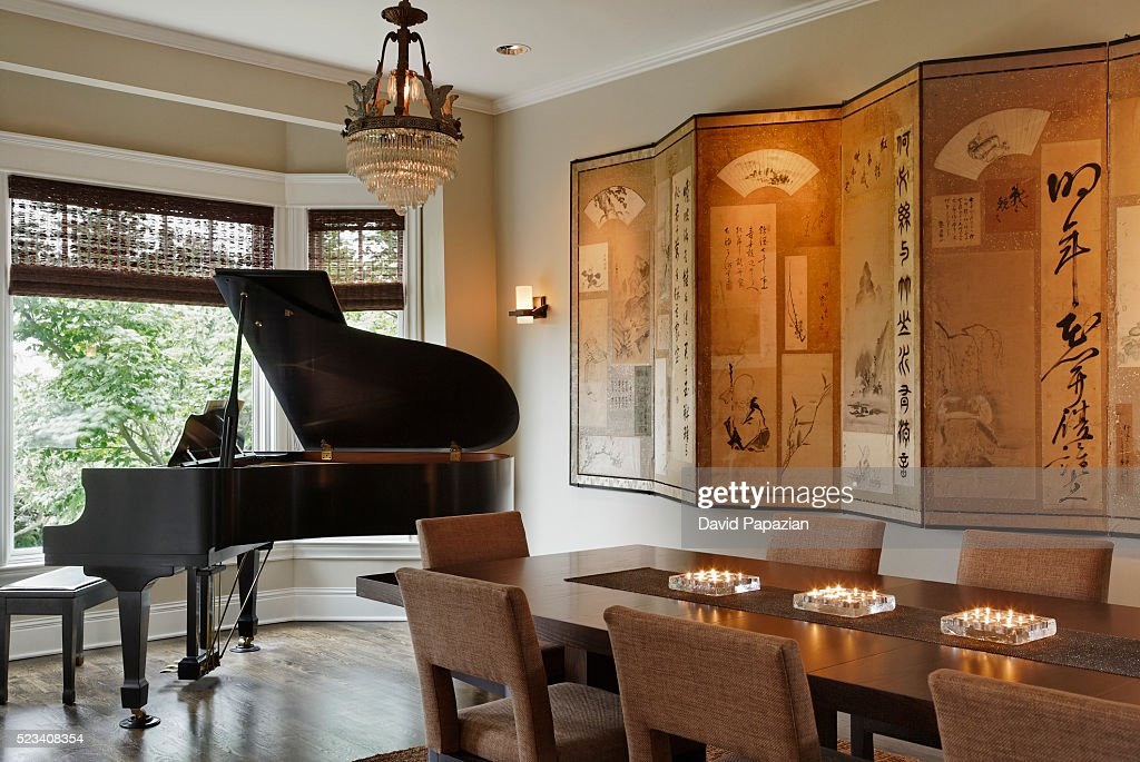 Contemporary dining room with piano  dining table and decorative Asian  screen   Stock PhotoContemporary Dining Room With Piano Dining Table And Decorative  . Piano Dining Room Table. Home Design Ideas