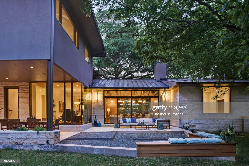 Contemporary House Exterior and Patio at Dusk