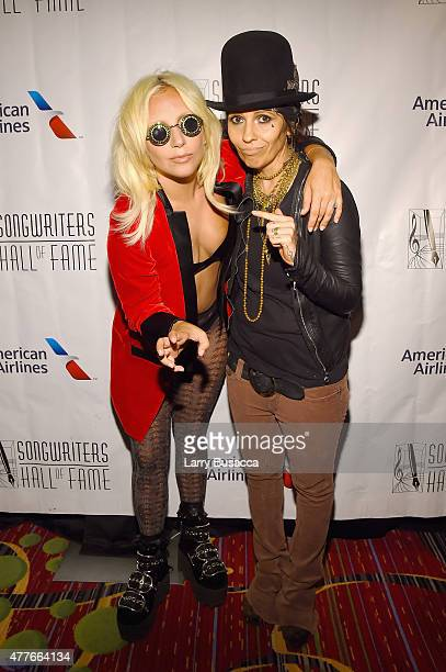 Contemporary Icon Award Recipient Lady Gaga and Inductee Linda Perry pose backstage at the Songwriters Hall Of Fame 46th Annual Induction And Awards...