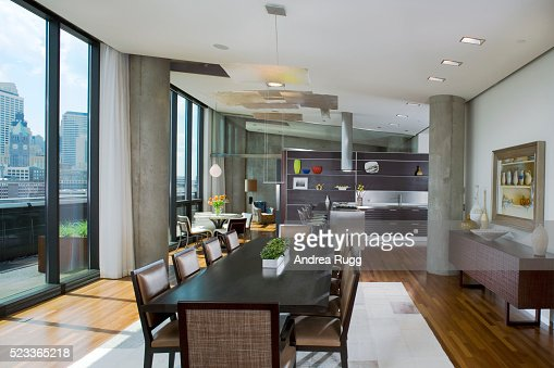 Stone Fireplace In Dining Room By Kitchen Stock Photo