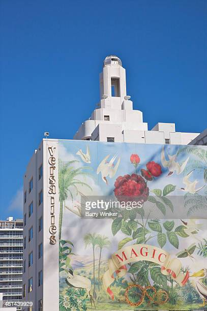 Contemporary mural on side of Art Deco hotel