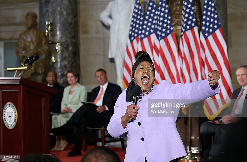 Contemporary opera singer <a gi-track='captionPersonalityLinkClicked' href=/galleries/search?phrase=Jessye+Norman&family=editorial&specificpeople=239491 ng-click='$event.stopPropagation()'>Jessye Norman</a>(2nd R) sings during a ceremony honoring the 50th anniversary of the March on Washington as U.S. Rep. John Lewis (D-GA) (L) , House Minority Leader <a gi-track='captionPersonalityLinkClicked' href=/galleries/search?phrase=Nancy+Pelosi&family=editorial&specificpeople=169883 ng-click='$event.stopPropagation()'>Nancy Pelosi</a> (D-CA) (2nd L), Speaker of the House John Boehner (R-OH) (C) and Senate Majority Leader Harry Reid (D-NV) listen July 31, 2013 in Washington, DC. The March on Washington began 50-year-ago on August 28, 1963.