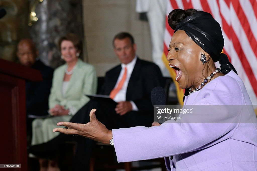 Contemporary opera singer Jessye Norman sings during a ceremony honoring the 50th anniversary of the March on Washington as (L to R) U.S. Rep. John Lewis (D-GA), House Minority Leader Nancy Pelosi (D-CA), and Speaker of the House John Boehner (R-OH) listen July 31, 2013 in Washington, DC. The March on Washington began 50-year-ago on August 28, 1963.