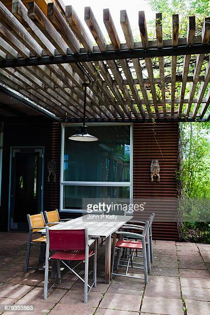 Contemporary pergola dining area