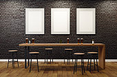 Contemporary black brick pub or bar interior with blank billboards on wall. Mock up, 3D Rendering