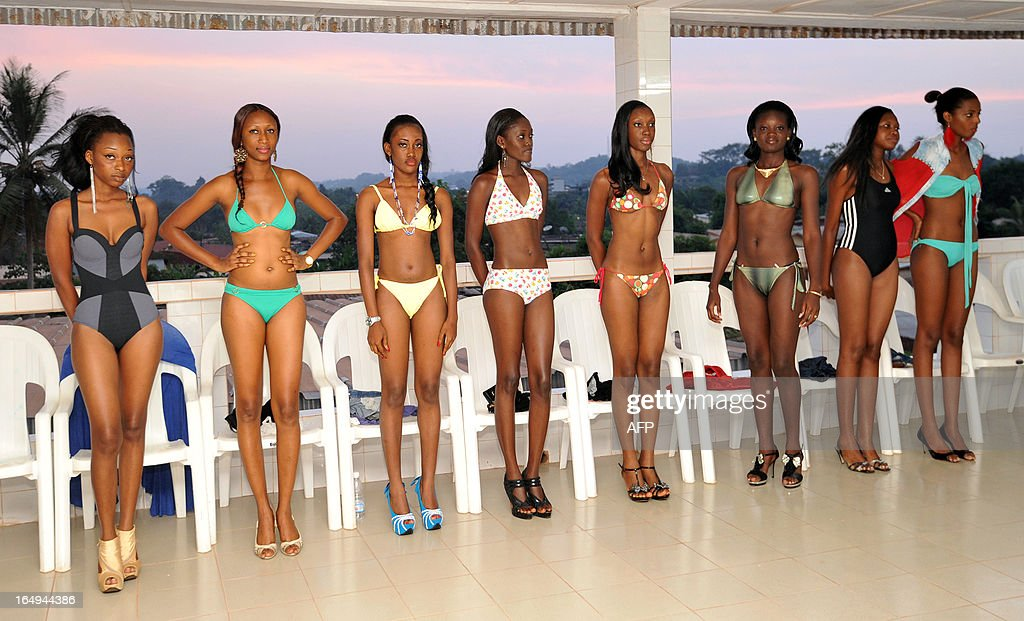 Contenders pose during a beauty pageant preselection ahead of the Miss Ivory Coast contest on March 22, 2013 in Anoissi in Ivory Coast. 'African' curves or an 'international' silhouette ? On the airwaves and the catwalks of the Ivory Coast a war of words has broken out between admirers of voluptuous female figures ('Lolo') and those who plump for a more streamlined western silhouette ('Lala'). AFP PHOTO/ SIA KAMBOU