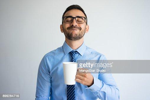 Content Business Man Enjoying Drinking Tea : Stock Photo