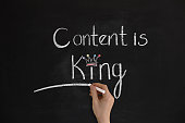 'Content is king' handwritten on chalkboard.