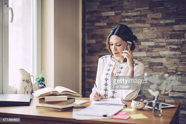 Content latin woman working at home