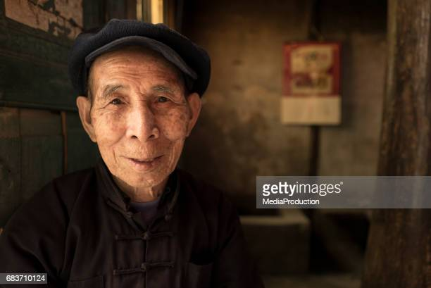 Content senior Chinese man portrait with copyspace