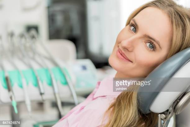 Content woman at dentist