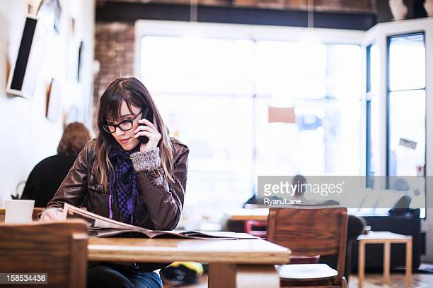 Content Woman in Cafe on Phone