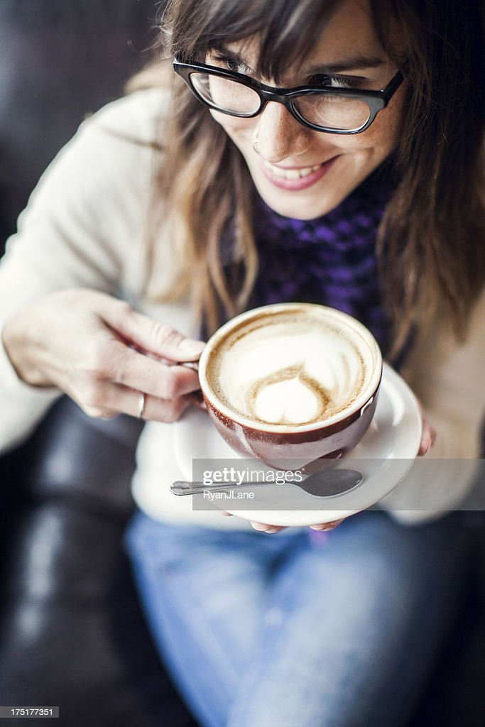 Content Woman with Latte : Stock Photo