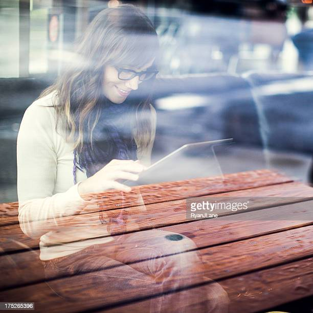 Content Woman with Tablet Computer in Cafe