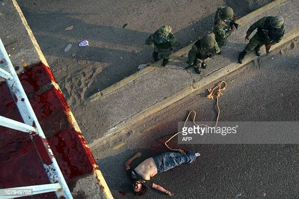 CONTENTMembers of Mexican Navy stand next to one of the three corpses one decapitated and partially dismembered found under the pedestrian bridge on...