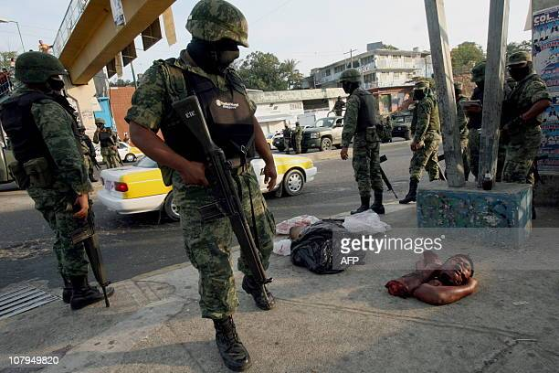CONTENTMembers of Mexican Navy surround one of the three corposes one decapitated and partially dismembered found on the AcapulcoMexico road in the...