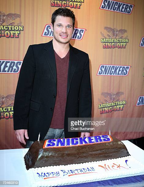 Contest judge Nick Lachey poses with his birthday cake at the finals of Snickers 'Satisfaction SingOff' at the House of Blues on November 8 2006 in...