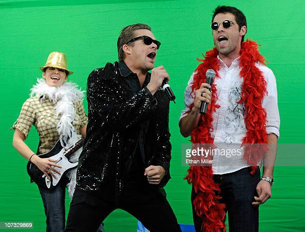 Contest winner Cari Shields of Ohio Sugar Ray singer Mark McGrath and contest winner Alex Balagna of Illinois perform with the music video game 'Rock...