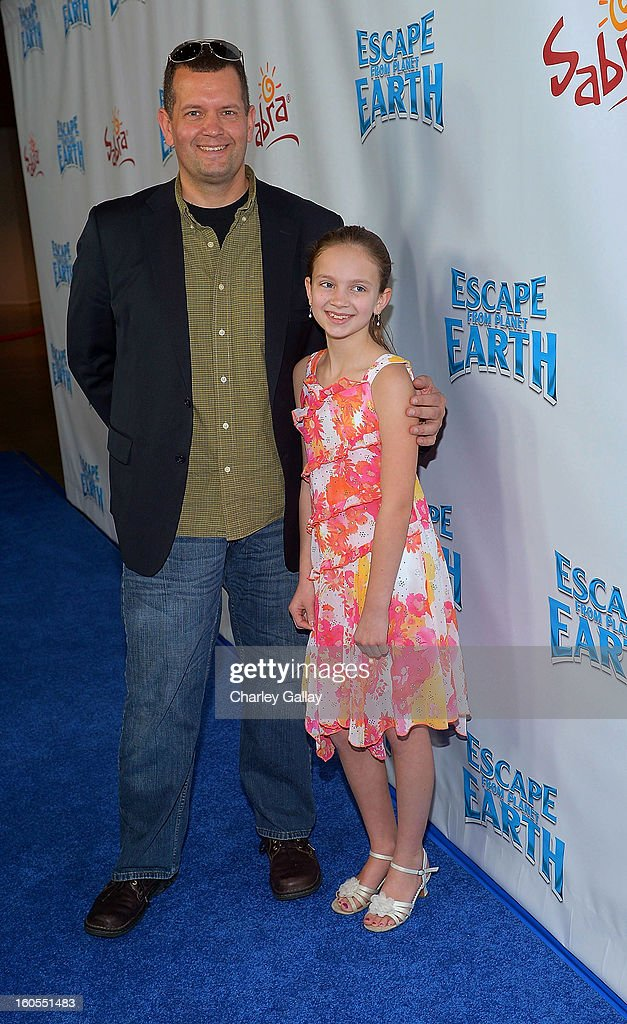 Contest winner Samantha Van Wicklin (R) attends the 'Escape From Planet Earth' premiere presented by The Weinstein Company in partnership with Sabra at Mann Chinese 6 on February 2, 2013 in Los Angeles, California.