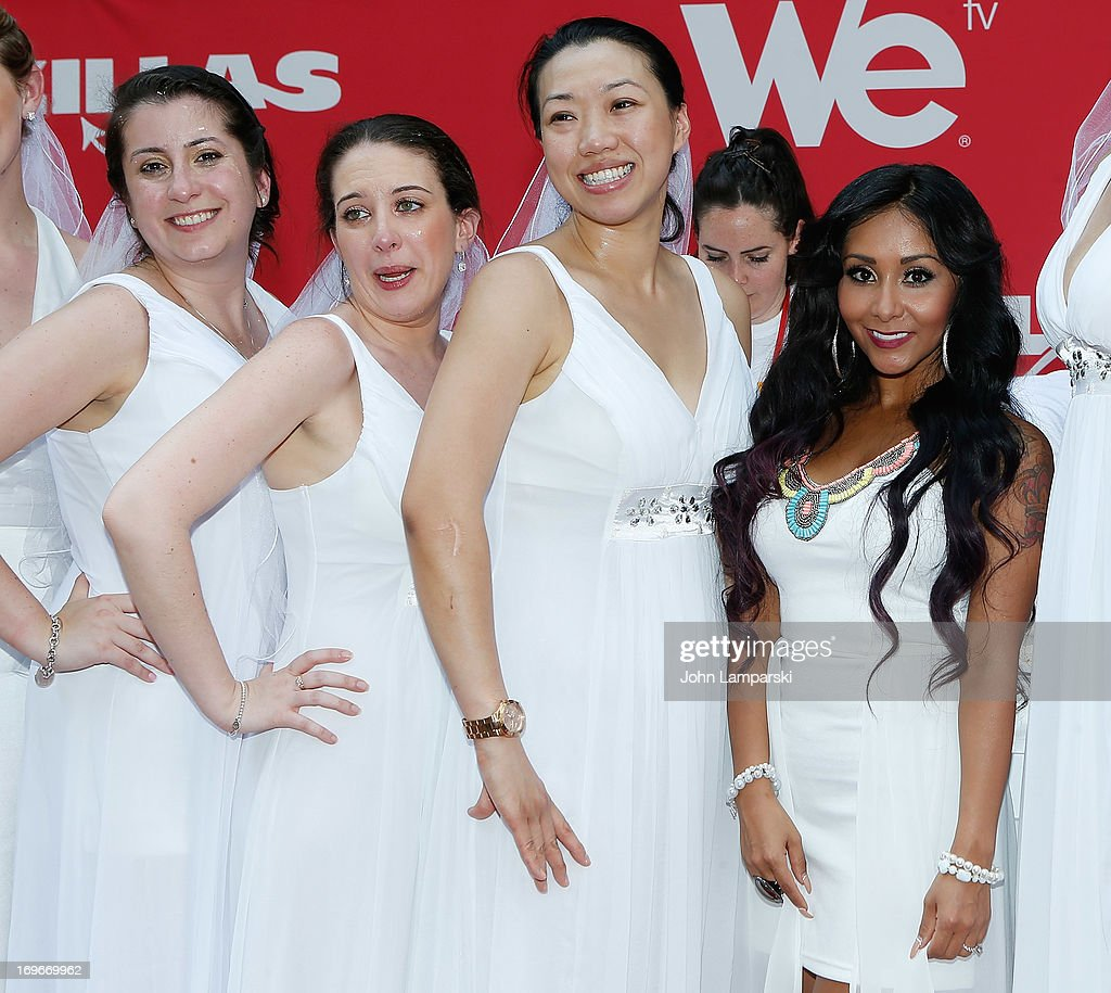 Contest Winnner Jennifer Paolotti (L) , Nicole 'Snooki ' Polizzi and contest participants attend the 'Bridezillas' Cake Eating Competition & WE TV's 10th Anniversary Celebration at Madison Square Garden on May 30, 2013 in New York City.