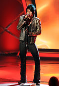 ACCESS*** Contestant Adam Lambert performs live on American Idol March 17 2009 in Los Angeles California The top 11 perform in front of the American...