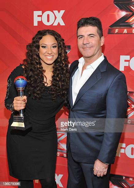 Contestant and winner Melanie Amaro and Judge Simon Cowell pose at Fox Television's 'The X Factor' Season Finale at CBS Television City on December...