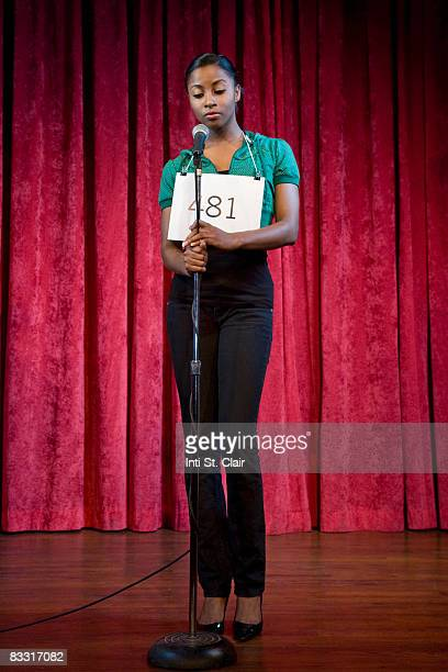 Contestant auditioning, standing at microphone