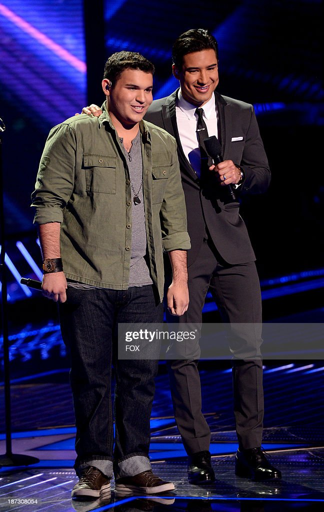 Contestant Carlos Guevara (L) and host Mario Lopez onstage on FOX's 'The X Factor' Season 3 Top 13 Perform Again Live on November 7, 2013 in Hollywood, California.