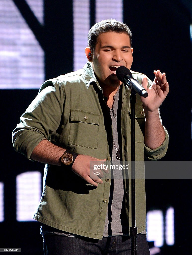 Contestant Carlos Guevara performs on FOX's 'The X Factor' Season 3 Top 13 Perform Again Live on November 7, 2013 in Hollywood, California.