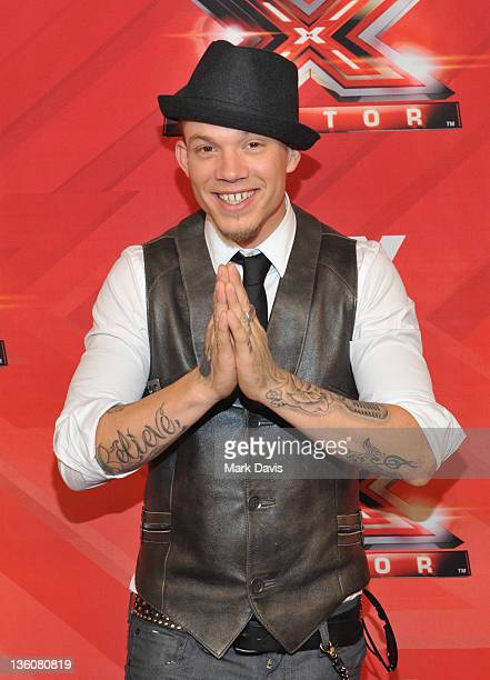 Contestant Chris Rene poses at Fox Television's 'The X Factor' Season Finale at CBS Television City on December 22 2011 in Los Angeles California