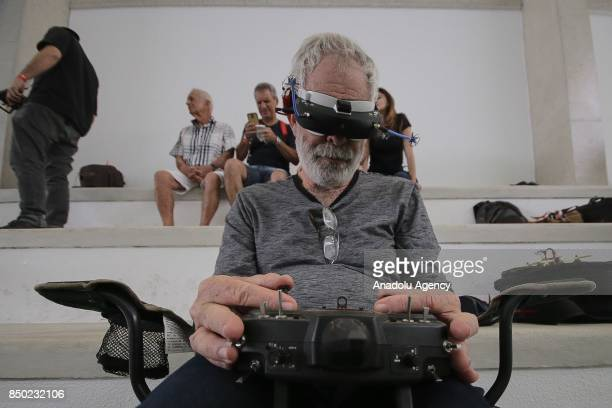 A contestant controls his racing drone with his firstperson view goggles during the Player 1 Drone League competition which brings the Brazilian...