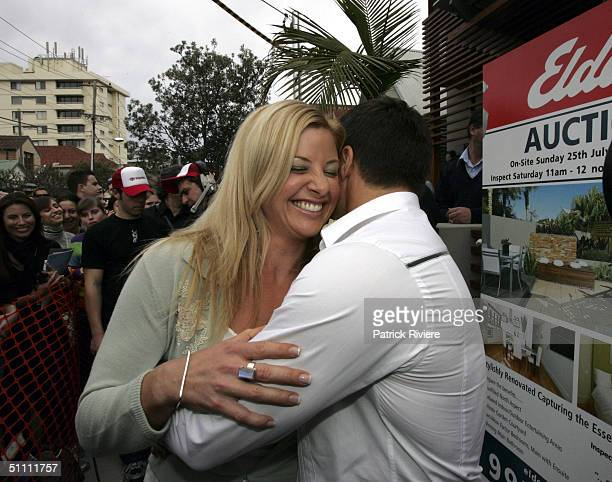 Contestant couple Jason and Kristen hug each other during the auction of the first two units of the second series of the reality television show 'The...