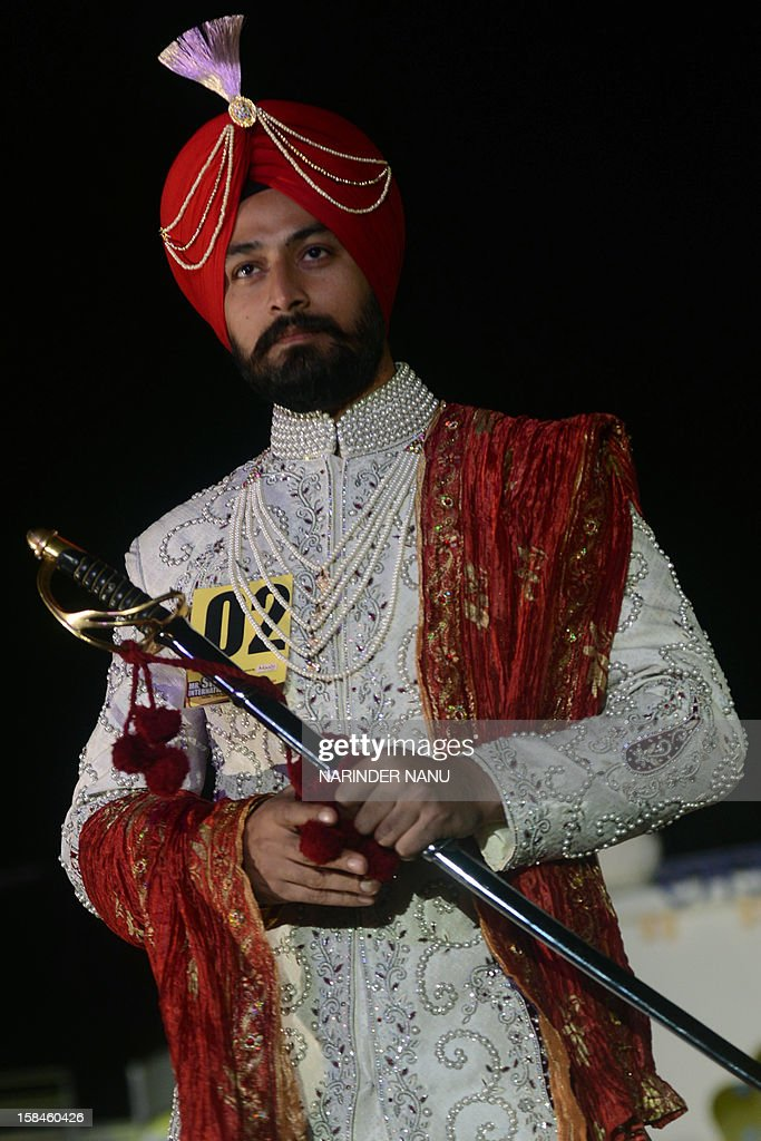A contestant displays traditional Sikh wedding groom attire during the Mr. Singh International Turban Pride 2012 Fashion Show in Amritsar late December 16,2012. A total of 26 contestants participated in the event in the northern Indian city.