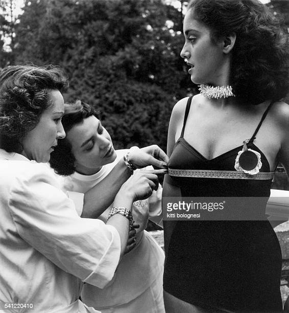A contestant in the 1949 Miss Italy competition has her bust measured