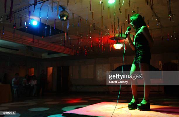 A contestant in the Ms Gay Kadayawan Pageant introduces 'herself' to the judges in the early morning hours of August 25 2002 in Davao Philippines...