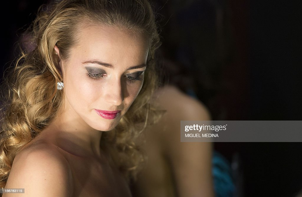 A contestant is pictured backstage on November 20, 2012 in the southern Paris suburb of Rungis during the 2012 Miss Ile-de-France (Greater Paris area) beauty contest.