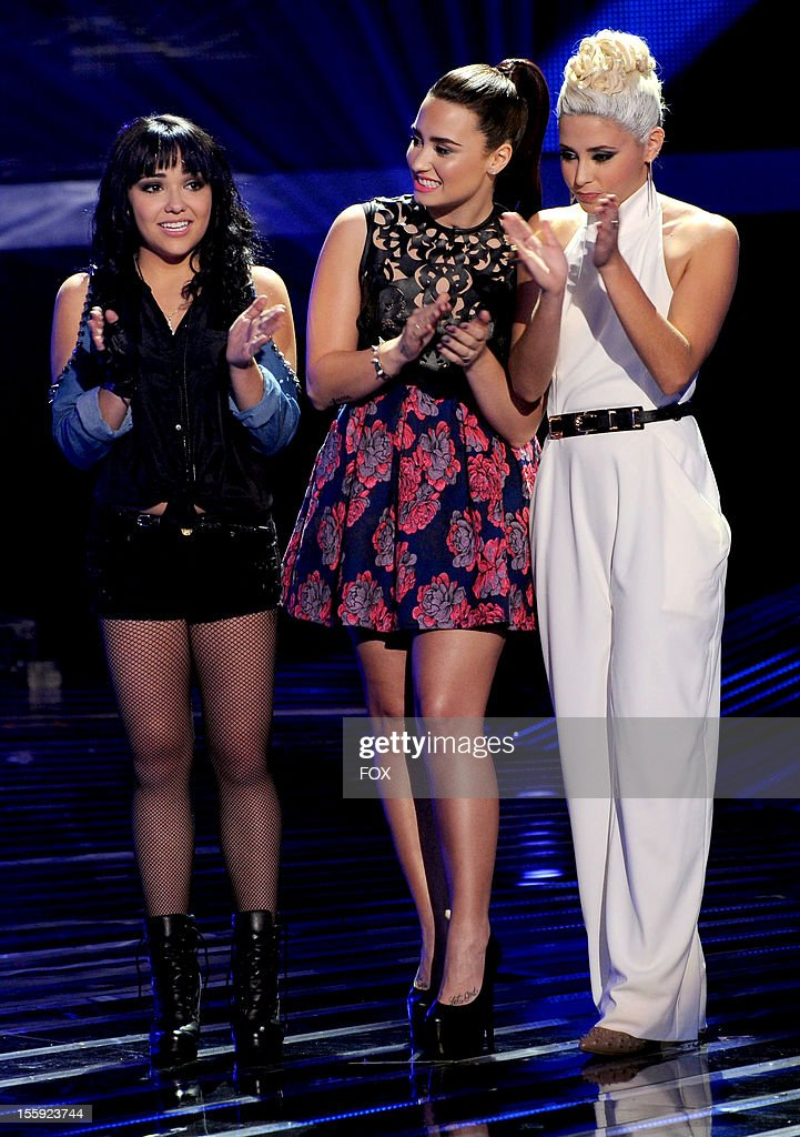 Contestant Jennel Garcia judge Demi Lovato and contestant Cece Frey onstage at FOX's 'The X Factor' Season 2 Top 13 To 12 Live Elimination Show on...