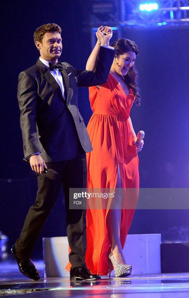 Contestant Kree Harrison (R) and host Ryan Seacrest onstage at FOX's 'American Idol' Season 12 Top 2 Live Performance Show at Nokia Theatre L.A. Live on May 15, 2013 in Los Angeles, California.
