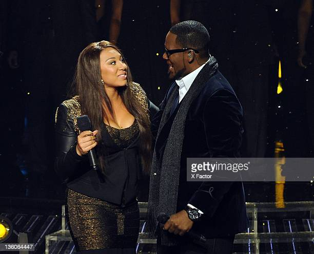 Contestant Melanie Amaro and singer R Kelly perform onstage at FOX's 'The X Factor' Top 3 Live Performance Show on December 21 2011 in Hollywood...