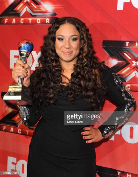 Contestant Melanie Amaro poses after winning season one of Fox Television's 'The X Factor' at CBS Television City on December 22 2011 in Los Angeles...